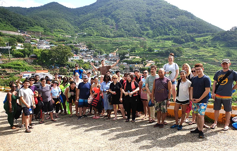Here is the group that went on the trip. We stood at a road going out of the village where we got a great view of the village built on the side of the mountain and all the rice paddies that were planted there.