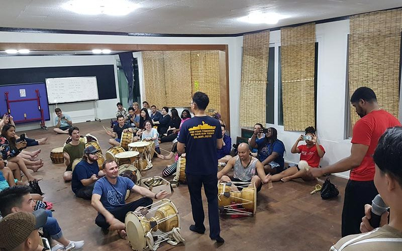 Learn how to play some traditional Korean drums with some help from the village manager